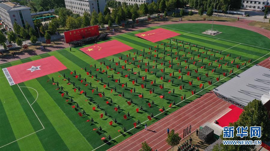 """(体育)(7)第七届世界军人运动会火炬传递活动第二站在""""开国大典红一师""""举行"""